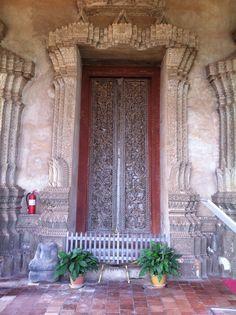 Door in Laos that I love; ha ha, the extinguisher.