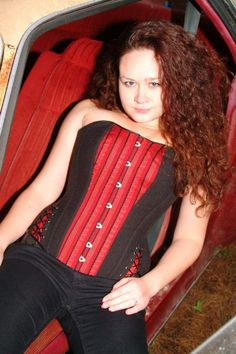 Red and black corset with extra lacing on the sides