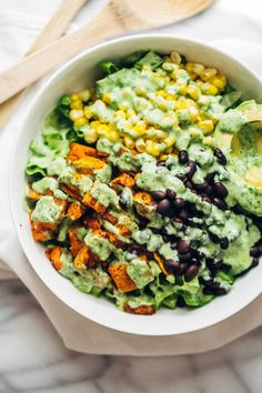 This healthy Spicy Southwestern Salad recipe has roasted sweet potatoes, black beans, corn, lettuce, and creamy avocado dressing!