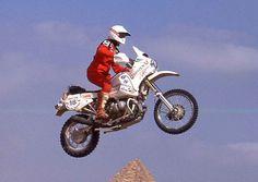 Dang! Jutta Kleinschidt back in the 1980s getting air during the Dakar... pyramid below!