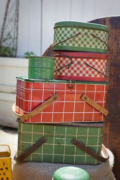 Vintage picnic baskets..the three on top are lunch pails, I have one just like the red one, it was my mother's lunch pail when she was girl in the mid 1940's