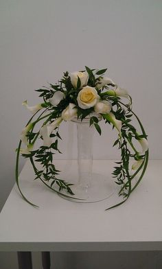 Perfect crescent bouquet by Tina Hodgson. This shape and simple design seems like it would be pretty with your cherub theme, and uses minimal flowers.