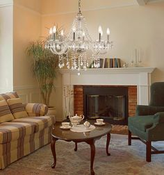Traditional Living Room Photo by Trans Globe Lighting - Homeclick Community Fireplace Tools, Home Fireplace, Traditional Fireplace, Traditional House, Wood Burning Insert, Crystal Light Fixture, Living Room Photos, Clear Crystal, Wall Sconces