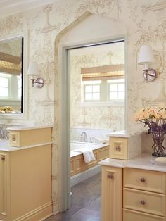 Lamp Sconces Classic lamp sconces add to the romantic feel of this 1920s-style bathroom. The white shades diffuse the glow of the lightbulbs and help to soften the light.