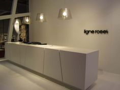 Ligne Roset contemporary clean white reception desk - Milan Furniture Fair 2011