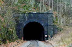 "The railroad tunnel nicknamed the ""Bloody Pit"" for taking the lives of hundreds during its construction"