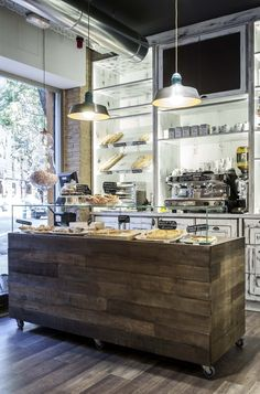 I like the wood (or bamboo might work better?) serving platter elements and the bread display behind the counter