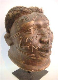 "A MAKONDE ""MAPICO"" INITIATION HELMET (MASK), (Mozambique). The mask displaying tribal facial scarification markings, a lip plug and human ha..."