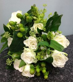 Beautiful cream and green country garden inspired wedding flowers