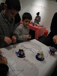 I robot pittori all'opera in #kidsinthecity. 5 febbraio 2016