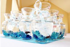 Beta Fish In A Vase for table decor, then have drawing/winning ticket under seat at each table to take it home- yes! :)