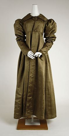 Pelisse circa 1814-1820, American. The Pelisse was similar to a modern coat; it was generally full length and followed the silhouette of the empire period. It was often padded with fur or other warm linings for winter. Pelisses were necessary due to the light airy dress style of the time.