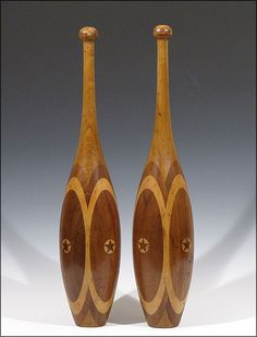 Large 4 Lb. Indian Clubs w/ Decorative Lathe Turned & Inlaid Design - Made from five different types of wood that were joined together in layers and then hand turned on a lathe into their final graceful shape, with the star inlay likely being added last.