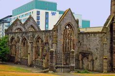 Charles Church was destroyed in war and is left as a memorial.  Modern Jury's Inn Hotel is seen across the street.