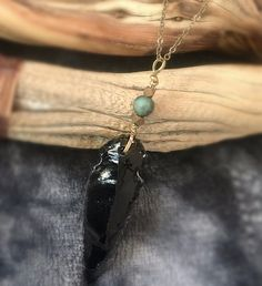 Obsidian Arrowhead Pendant with Hematite and African Turquoise  Let the warrior goddess within you shine in this handcrafted healing necklace by Soul Sisters Designs