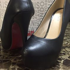 Black Heeled Shoes With A Red Sole