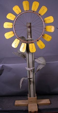 Sunflower Whirligig - Bicycle wheel, tin and wood construction. 73 x 34 x 26.
