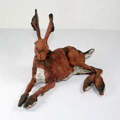 Little lying sideways ceramic hare - by Elaine Peto available at www.thewowgallery.co.uk for £185. On of these handcrafted ceramic hares  was the chosen gift on House Gift 3 years ago! Only it was a 12in tall upright one!
