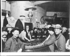 View of a craps game inside a western saloon, ca.1890-1910 :: California Historical Society Collection