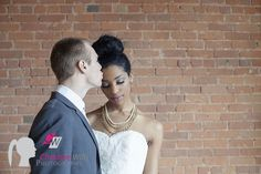 http://www.cwillsphotography.com, edmonton wedding photography, edmonton wedding photographer, bride and groom, first kiss photo, indoor wedding photography, brick wall backdrop,  new york loft style wedding photos