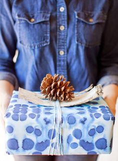 From Poppytalk | Features: Sycamore Street Press's Indigo papers, bark from The Flower Factory, and pinecones from Pinecone Camp. | Photographer Janis Nicolay | #holidays #giftwrap #wrappingideas #christmasgift #present