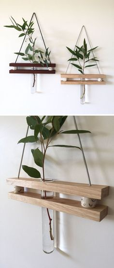 These Small Shelves Hang On Your Wall Just Like A Piece Of Art These modern hanging wall shelves made from reclaimed wood have a ledge to display a little trinket and a bud vase for a flower.