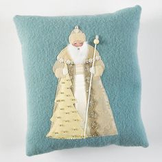 Old-World Santa Pillow - A throw pillow featuring Santa Claus is a fun and easy Christmas craft. With soft fabrics and fancy trims, this old-world Santa applique will add classic (and cozy) charm to your Christmas decor.