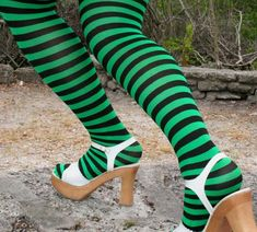 Plus Sized Black Striped Tights    Your size is available here in black with any of our 51 solid colors stripes. Have fun for any occasion these plus sized striped tights are soft and comfortable. Colors shown are kelly green and black stripes, also lilac and black stripes.  $12.00