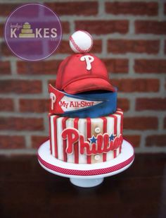Philadelphia Phillies Cake! Bottom 2 tiers iced in buttercream. Hat is cake covered in marshmallow fondant (MMF). MMF pennant, logo, decorations. Chocolate baseball.
