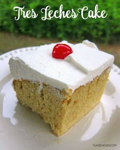 """Tres Leche Cake Recipe - delicious poke cake recipe - yellow cake mix, topped with sweetened condensed milk, evaporated milk and half and half - top the milk soaked cake with whipped cream and cherries! My husband took one bite and said """"This is dang good!"""" - totally agree! Love at first bite!"""