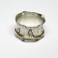Birds on a Wire Sterling Silver and 10k Gold Spinner Ring. $185.00, via Etsy.