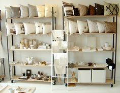 Clean, open shelving. Large pillows on top, smaller items at arm's reach in middle.    Simplemente Blanco by decor8, via Flickr