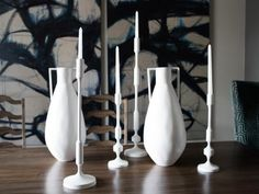 The+tall+white+ceramic+pieces+on+top+of+the+dining+table+give+the+space+a+curated+look.