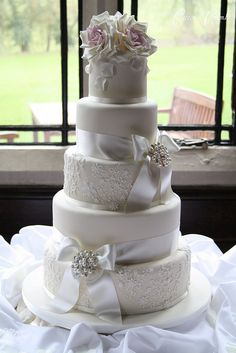 Elegant lace wedding cake by Cotton and Crumbs, via Flickr