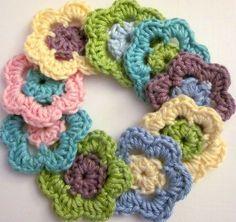 1 Sett m/9 hekla blomster i vårlige farger.