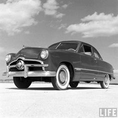 1949 Ford.. In 1962 dad saw me standing behind this car with the engine running and quickly led me away from the fumes.. we moved from Parkdale Tract to the ranch where dad left it.. Mr. Zeff's kids upholstered it and dropped an engine in it.. but for some reason it was never driven