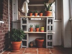 Big Cinder Block Shelves As Plant Stand With Wooden Planks On Brown Tile Flooring For Outdoor Patio Decoration Idea. Amazing Idea Of DIY Cinder Block Shelves Wooden Plant Stands, Diy Plant Stand, Cinder Block Shelves, Cinder Blocks, Cinder Block Furniture, Cinder Block Garden, Garden Shelves, Porch Garden, Exposed Brick Walls