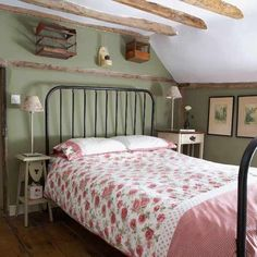 Pretty country bedroom...love the mix of floral and checks for the bed linens. Wide plank floors and exposed wood beams give this an old country feel.