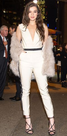 Hailee Steinfeld in a cream jumpsuit and fur jacket