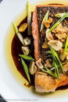 Crispy Salmon with Ginger Soy Sauce - This recipe combines the delicate flavor of Chinese steamed fish with the crispy skin of grilled salmon in one dish. Isn't it perfect? | http://omnivorescookbook.com