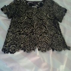 2b bebe pullover top Black and gold pullover top. Worn but in great shape. Colors are black and gold bebe Tops