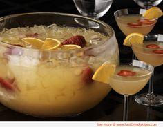 Mimosa Punch Recipe:  2 quarts of fresh orange juice 1 2-liter bottle of ginger ale 1/2 cup orange liqueur (Grand Marnier) Orange slices Fresh strawberries, sliced or halved depending on size 1 (750 ml) bottle chilled dry Champagne or sparkling wine ice cubes