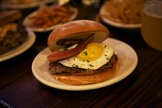DMK Burger- The #4 has roasted hatch green chile, one fried farm egg, Sonoma jack cheese and topped off with smoked bacon.------yum