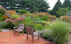 The warm tones of this brick patio perfectly highlight the richness of the plantings in late summer. Design by Fernhill Landscapes in Strasburg, PA. For more photos of this landscape, visit: http://www.landscapingnetwork.com/pictures/naturalistic-garden-tour_57/17579-pa-fernhill-landscapes_3778/