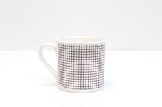 Monochrome 'Grid' design Bone China mug. Each mug has it's design individually transferred onto it by hand in Rolfe&Wills's Bristol.    Contemporary Design