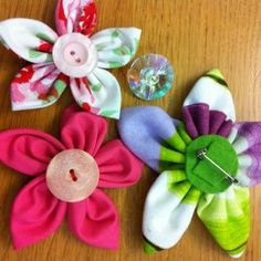 How to make colorful fabric flowers via @Guidecentral - Visit www.guidecentr.al for more #DIY #tutorials