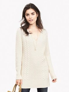 Love this sweater.  Love the necklace with it as well.  I'm thinking leggings and booties with this or skinny jeans and riding boots.