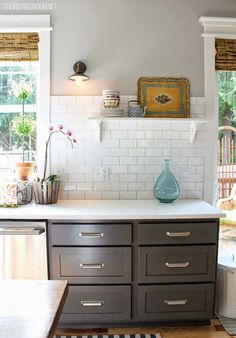 Ben Moore Kendall Charcoal painted lower kitchen cabinets