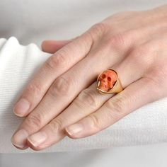 An amazing coral and gold skull ring from the Victorian era! The coral is meticulously hand carved so that it creates a detailed miniature replica of a human skull, which is finished with heavy and smooth 18k band. This ring is definitely a statement piece! Available at abrandtandson.com
