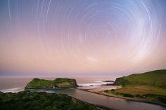 Landscape photo of a star trail over hole in the wall, a free standing cliff on South Africa's coastline Star Trails, Landscape Photos, Cliff, South Africa, Filter, Coast, African, Ocean, Wall